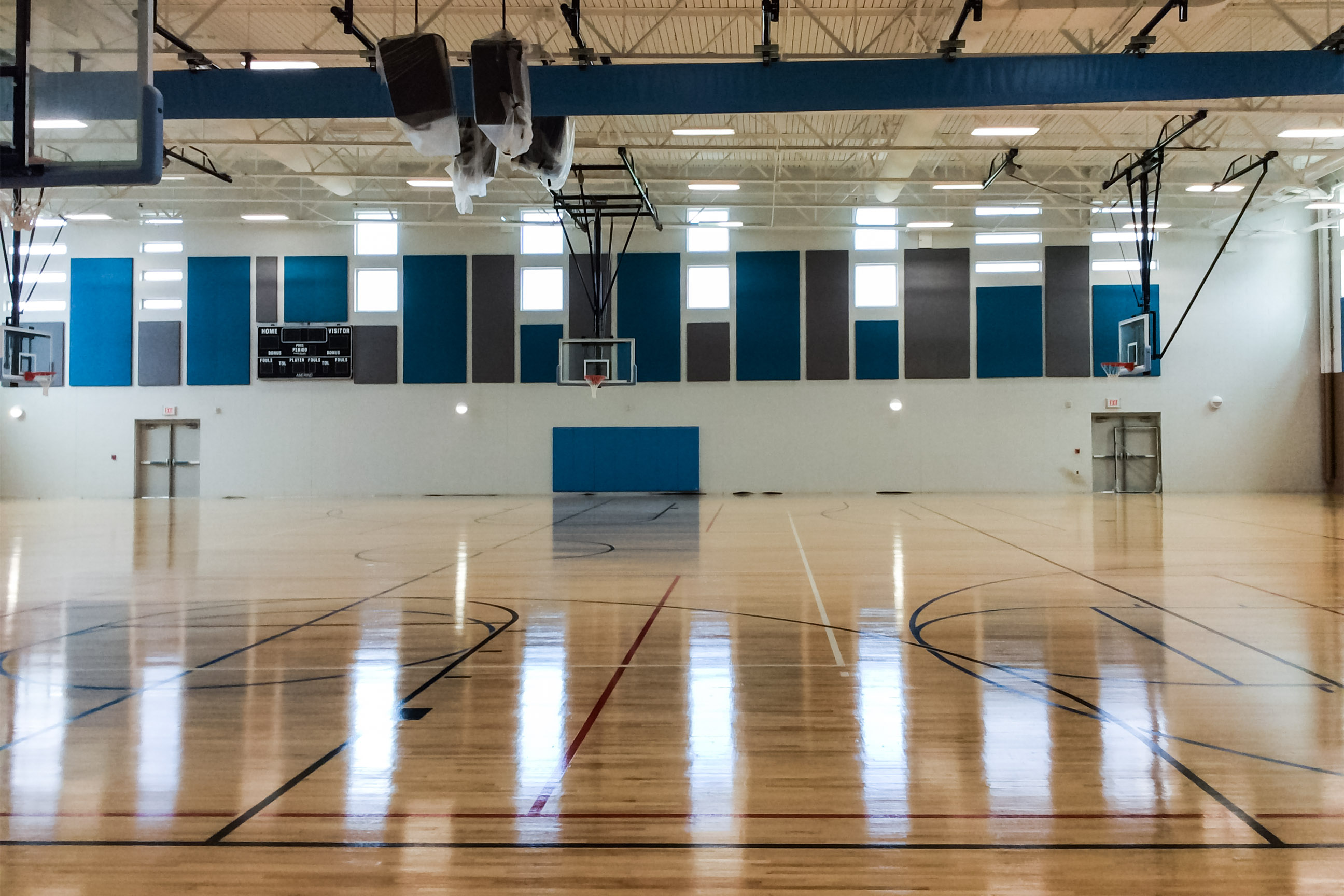 photo of acoustic fabric covered panels in gymnasium in New Mexico-2